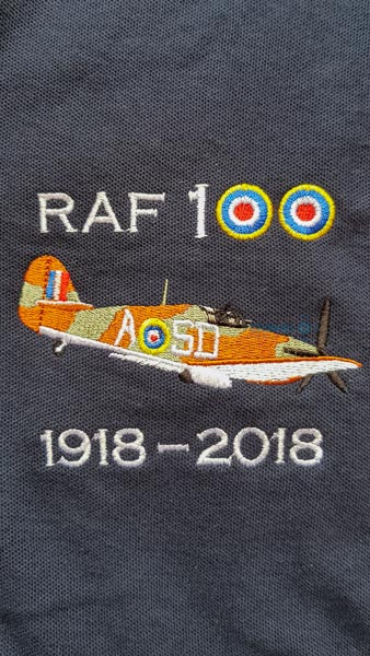 Navy blue RAF 100 Anniversary embroidered polo shirt featuring an RAF Hawker Hurricane