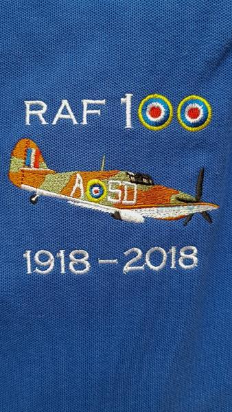 Royal blue RAF 100 Anniversary embroidered polo shirt featuring an RAF Hawker Hurricane