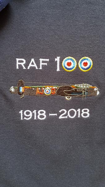 Navy blue RAF 100 Anniversary embroidered polo shirt featuring featuring an RAF Lancaster AJ-G from 617 Squadron
