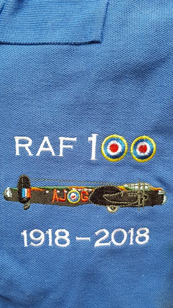 Royal blue RAF 100 Anniversary embroidered polo shirt featuring featuring an RAF Lancaster AJ-G from 617 Squadron