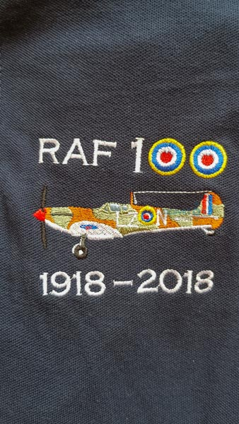 Navy blue RAF 100 Anniversary embroidered polo shirt featuring an RAF Spitfire from 66 Squadron