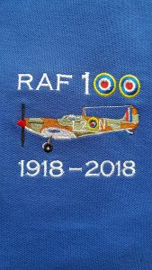 Royal blue RAF 100 Anniversary embroidered polo shirt featuring an RAF Spitfire from 66 Squadron
