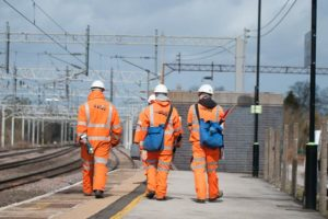 Network Rail Maintenance Engineers walking along Rugeley Trent Valley Railway Station