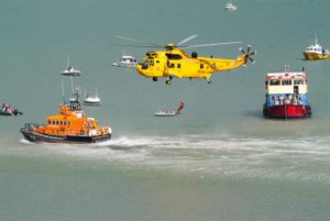 Royal Air Force air sea rescue Sea King helicopter undertaking a dramatic rescue with the Exmouth Lifeboat