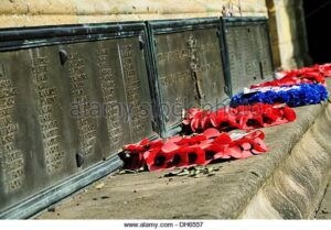 wreaths-of-poppies-laid-next-to-names-of-fallen-soldiers-at-the-foot-DH6557