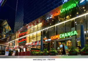 FBCHYR Night view of Chimichanga Mexican restaurant and Frankie and Bennys outside the Highcross shopping centre in Leicester