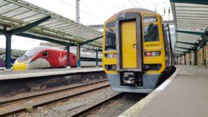 Northern class 158 and Virgin trains class 390 pendolino at Carlisle