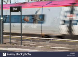 Virgin Pendolino train at high speed through Nuneaton Railway Station
